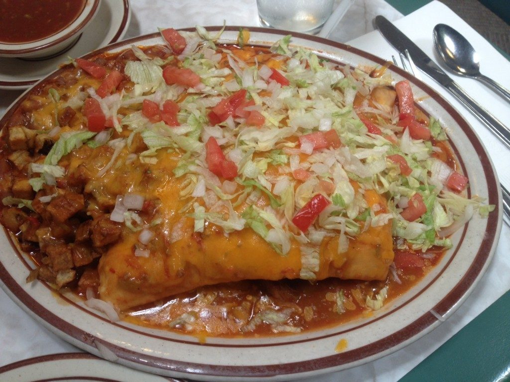 Sopapilla - mouthwatering deep fried pastry stuffed with meat and smothered in cheese.. yes yes yes!
