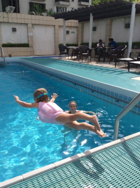 Sky jumping in pool - shrink