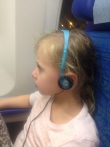 Cathay often give out kids headphones - keep them & reuse