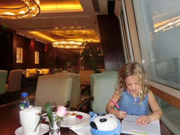 Daisy writing travel diary - shrink