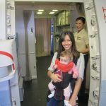 Tara stepping off plane - shrink