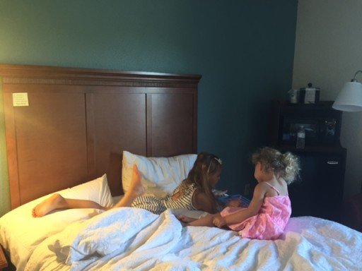 Kids on bed with ipad