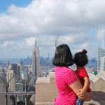 Me and daughter looking out at NYC from Top of the Rock